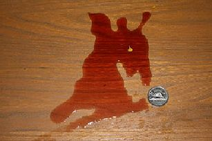 red wine spill on a hardwood floor